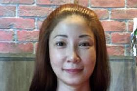 ACCUSED: Guan Enmei, an ex-wife of alleged match fixer Dan Tan Seet Eng, disputed the charge of giving false information.