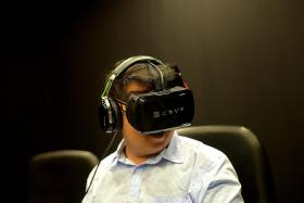 GAME CHANGER: The New Paper reporter Ng Jun Sen trying out the Open Source Virtual Reality by Razer Inc.