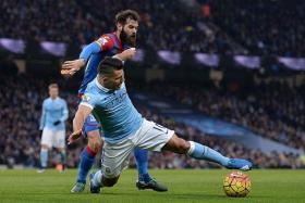 LETHAL: Despite the close attention from Palace defenders, Sergio Aguero still managed to score twice in Manchester City's easy win.