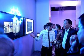 TECHNOLOGICAL BOOST: Deputy Prime Minister Teo Chee Hean (far right) gets a briefing on how the Dartfish technology would work at the Singapore Bowling@Rifle Range last night.