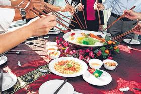 CHANGES: Your traditional yusheng this year may not come with raw salmon.