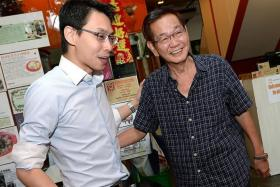 REUNION: Mr Tan Han Theng (right) met Mr Edwin Huang for the first time on Thursday since the incident.