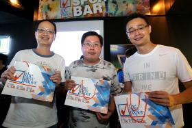 AT THE TNP SPORTS BAR: Daniel Ang Ming Yi (far right) is one of the three winners picked for predicting the correct half-time score.
