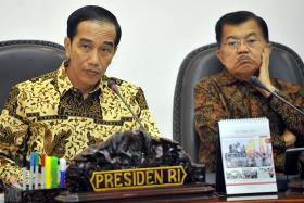 Indonesia's President Joko Widodo (left) warned that the forest fires are once again making an appearance and that they should be vigilant to prevent the haze from occurring once again.He is seen here with Vice President Jusuf Kalla at a cabinet meeting on the haze in October 2015