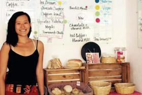 A TASTE FOR HELPING OTHERS: Miss Denise Lim in her bakery (left) and restaurant (above).