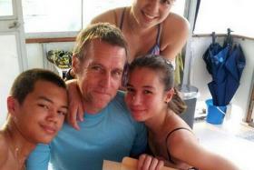 GOOD DEED: Mr Alan Bickham with his three children, Ryan, Alison and Melanie.