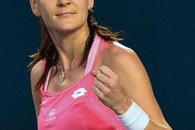 CONFIDENT: Radwanska is (above) very happy with her game.