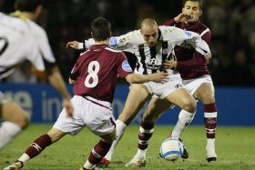 THE MISSING CONNECTION? Former St Mirren striker Billy Mehmet (in black and white) fits the targetman profile that Tampines Rovers are looking for.