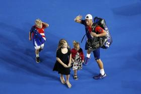 """""""I've had so much success in big matches on this court and I feel fortunate to finish here. It's the perfect place to finish."""" - Lleyton Hewitt (above, with his children)"""