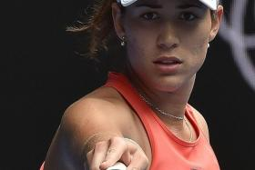 EYEING THE TITLE: Garbine Muguruza (above) advances to the third round and has been tipped as a future world No. 1.