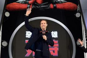 IN ASIA: US actor Ryan Reynolds getting a warm welcome on the red carpet at Deadpool's premiere at Vie Show Cinemas in Taipei on Thursday.