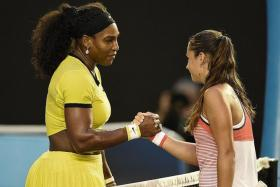 WORDS OF ENCOURAGEMENT: Serena Williams consoles a stunned Daria Kasatkina, saying that the young Russian has a bright future ahead of her.