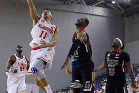 ON FORM: Singapore Slingers' Kris Rosales (above) goes up for a lay-up against the Pilipinas MX3 Kings.