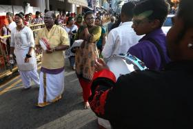 SUPPORT: A group of singers cheer the kavadi carriers on as they walk down Serangoon Road during yesterday's Thaipusam procession.