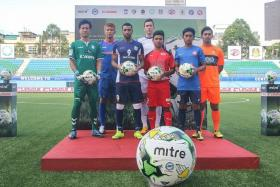 SUPPORT: Players from various S.League clubs, including Tampines Rovers' Jermaine Pennant (third from left) at the unveiling of Mitre as the league's official ball yesterday.