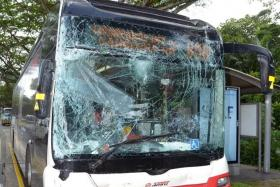 CRASH: Bus service 858 (above) hit the rear of bus service 854 when 854 stopped suddenly.