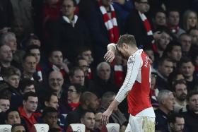SURRENDER: Arsenal never fully recovered from Per Mertesacker's (above) 18th-minute sending-off against Chelsea yesterday.