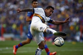 File photo of Boca Juniors' striker Carlos Tevez.