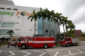 AT THE SCENE: The Singapore Civil Defence Force was alerted to the fire at the Bagus foodcourt at Causeway Point yesterday morning.