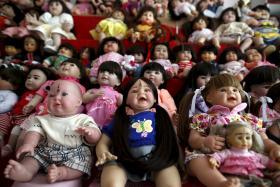 """""""Child angel"""" dolls at a shop in Nonthaburi, Thailand."""