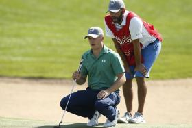 SWITCH: Jordan Spieth (in green) will be using his manager Jay Danzi as his bag man after his caddie Michael Greller (right) injured his knee at the Abu Dhabi HSBC Championship last week.