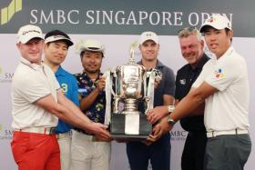 PRIZED PURSUIT: World No. 1 Jordan Spieth (fourth from far left) with other contenders (from far left) Jamie Donaldson, Yang Yong Eun, Shingo Katayama, Darren Clarke and An Byeong Hun getting a feel of the Singapore Open trophy yesterday.