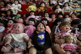 LUCKY CHARM? The 'child angel' dolls are believed to bring their owners good luck.