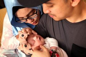 Local celebrity couple (from left) Malaque Mahdaly and Syarif welcomed their firstborn Selma Malika on Dec 31.