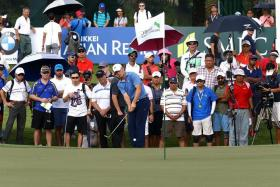 CROWD-PULLER: All eyes are on Jordan Spieth (holding club) on the first day of the SMBC Singapore Open.