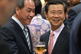 ALL SMILES: Mr Low Thia Khiang (left) and former minister Wong Kan Seng at the reception for the opening of Parliament.