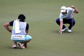 LEADERS: Song Young Han (above right) and Shintaro Kobayashi, who is a shot behind, are the frontrunners at the storm-hit SMBC Singapore Open.