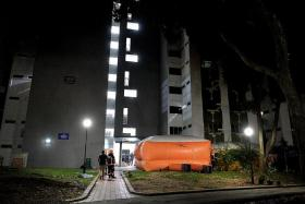 FOR SAFETY: Two safety life air packs were set up under the block in Boon Lay as a precautionary measure.