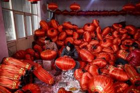 ON THE JOB: A worker assembling lanterns in the village of Tuntou, in Hebei province southwest of Beijing, for the upcoming Chinese New Year, the biggest holiday of the year in the world's most populous country.