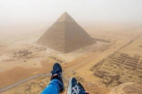 AT THE TOP: German teenager Andrej Ciesielski shared on social media photos that he took from his illegal climb up the Great Pyramid of Giza in Egypt.