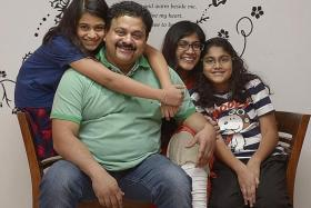 AT HOME: Mr Samir Salim Neji, pictured with his wife and daughters, became a citizen in 2004. He agrees with MP Darryl David's suggestion of additional assimilation requirements.