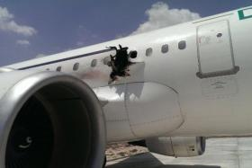 A photo depicts the hole in the fuselage of a Daallo Airlines jet after an explosion forced it to return to Somalia.
