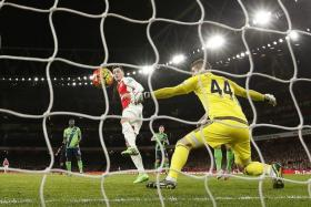 UNBEATABLE: Arsenal's Mesut Oezil (second from left) and Co could not find a way past Southampton's inspired goalkeeper Fraser Forster (near left).