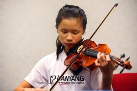 UNBOWED: Despite her loss of vision, Miss Soon excels in playing the violin.