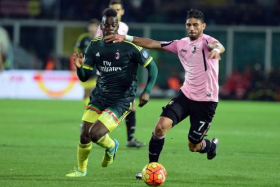 AC Milan striker Mario Balotelli (left) vies for a ball with a Palermo defender in a Serie A match in his hometown of Palermo on Feb 3.