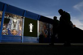 NOT SO LONG AGO: Fans walking outside Stamford Bridge, where pictures of their glorious moments in recent years remind them how fast fortunes can change in football.