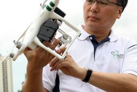 DRONE: Mr Pang Kin Keong checking out the DragonFly.