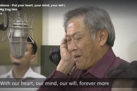 Defence Minister Ng Eng Hen sings his part in an updated version of 1984's Total Defence song.