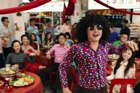 NEW YEAR CHEER: Chen Tianwen and his son Genghis preparing for Chinese New Year this year. (Above) Chen (in afro) in his latest work, a new music video Happy Together for upcoming Channel 8 show Don't Worry, Be Healthy.