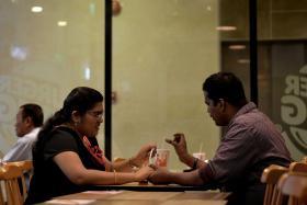 TOGETHER: Mr Jothiramalingam Samikkannu, an Indian national, and Madam Kalpana Venkatachalam, a Singaporean, tied the knot in 2011 after meeting through an online matrimony site.