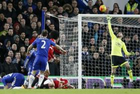 TOP SAVES: David de Gea pulling off a stupendous save against Chelsea's Branislav Ivanovic (above) and keeping out efforts from Newcastle and Liverpool.