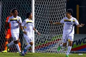 JOY: Woodlands Wellington players (above) celebrate a goal during their last season in the S.League in 2014.
