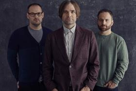 TRIO: Death Cab For Cutie members (from left) Jason McGerr, Ben Gibbard and Nick Harmer. (Inset) Guitarist Chris Walla left the band in 2014 to pursue a solo career.