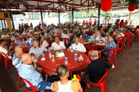 FESTIVE CHEER: Some 200 elderly folk living in rental flats at Bukit Merah enjoying a Chinese New Year lunch celebration organised by the charity project 'A Packet of Rice'.