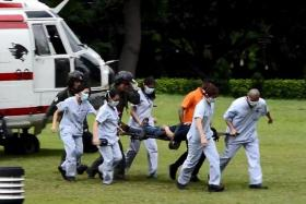'LIKE CLOCKWORK': The patient being transferred from the rescue helicopter to an ambulance which rushed him to Singapore General Hospital.