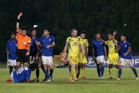 OVERSEAS VENTURE: Harimau Muda (in blue) participated in the S.League until last year, concluding the Football Association of Malaysia's four-year agreement to have a youth side compete here.